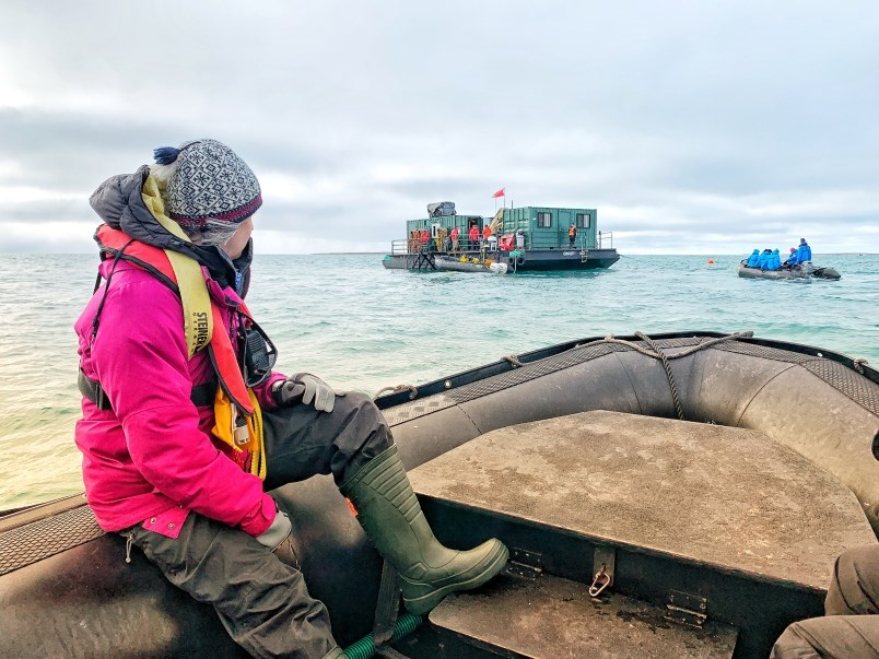 The excitement mounts as the Adventure Canada Zodiacs line up for their turn exploring the diving barge used to explore the Erebus shipwreck. (via Jennifer Bain)