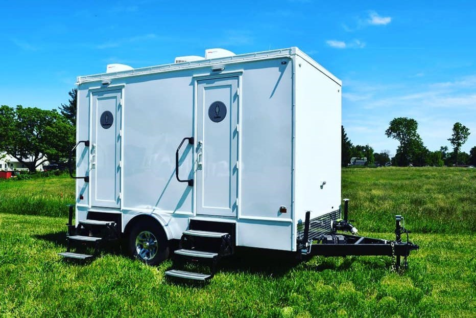 The Lux Loo offers bathrooms in a trailer for your outdoor events. (via Michael Letterlough)