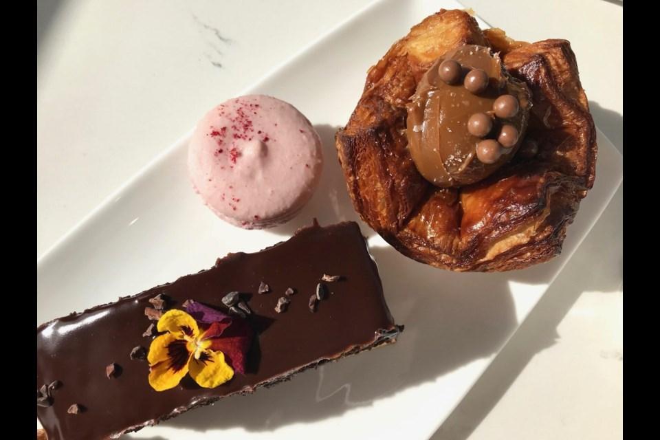 Chocolate quinoa cake, macaron and kouign amann. (via Emiko Ohama)