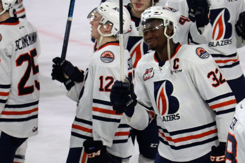 A tearful Jermaine Loewen raises his stick to the Sandman Centre rafter for the final time. After five seasons, his Kamloops Blazers career is over. (via Eric Thompson)