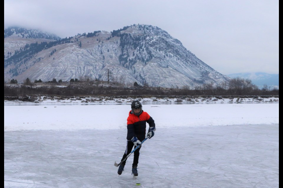 Kids and dads play hockey on an impromptu rink on the North Thompson River in North Kamloops. (via Brendan Kergin)