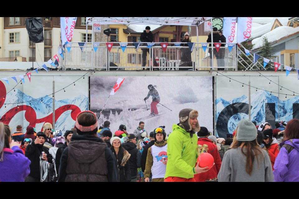 A DJ plays above an afternoon crowd of revellers at Snowbombing in 2018. (via Brendan Kergin)