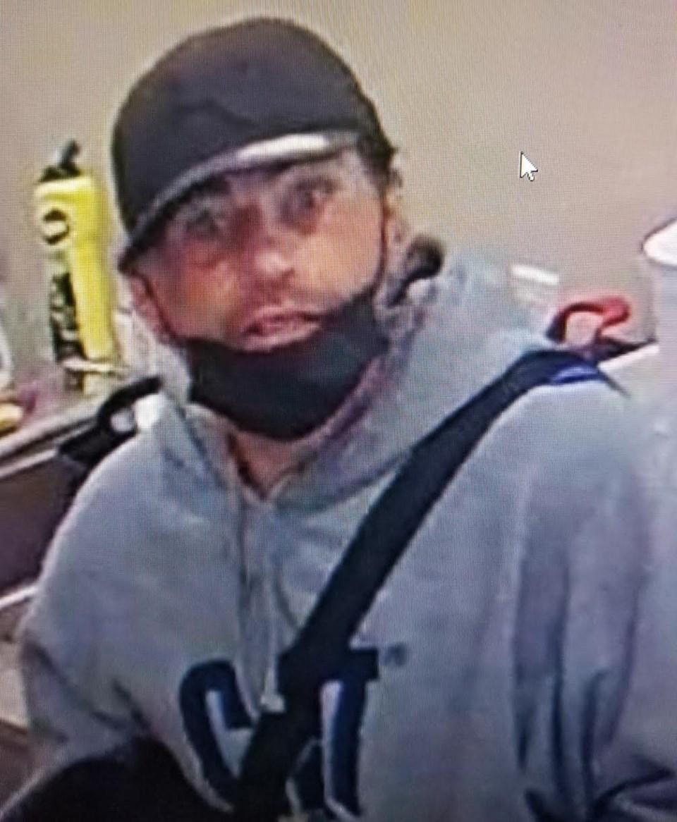 purse thief suspect