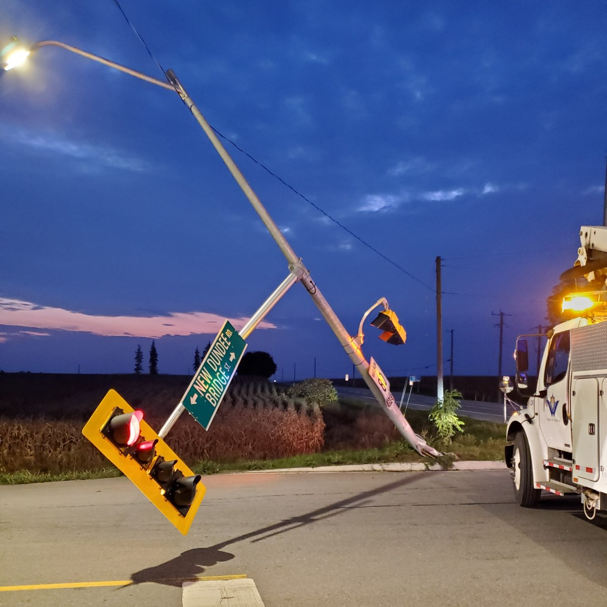 Part of Trussler Road closed after driver of transport truck takes out traffic light