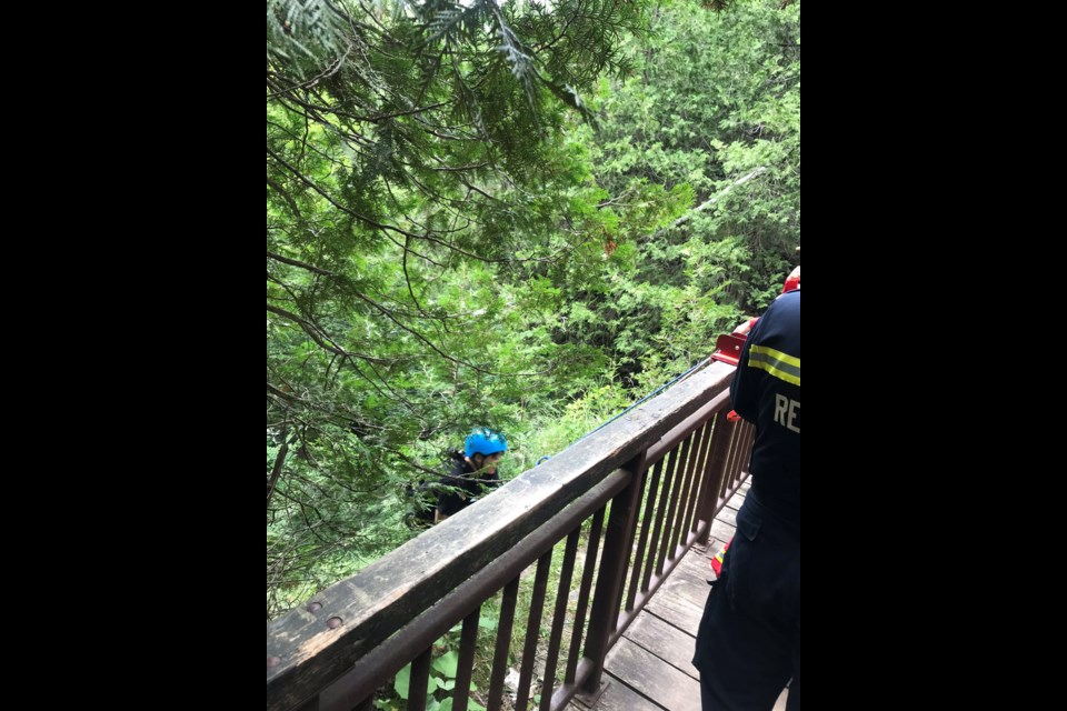 A tuber climbs up the slope along the Elora Gorge. Photo from @karnDC2 on Twitter.