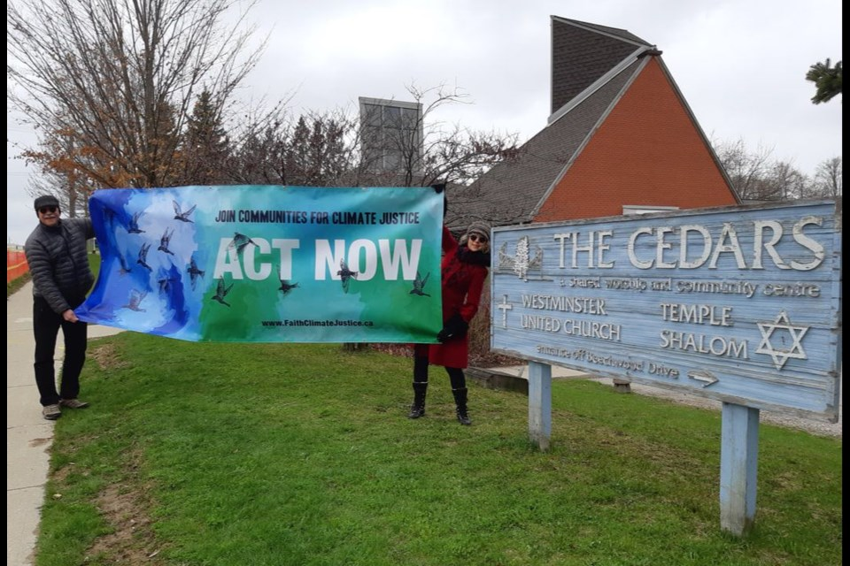 Westminister Church and Temple Shalom have joined their awareness efforts. Here they are seen holding their joint banner. Photo courtesy of Faith Climate Justice Waterloo Region.