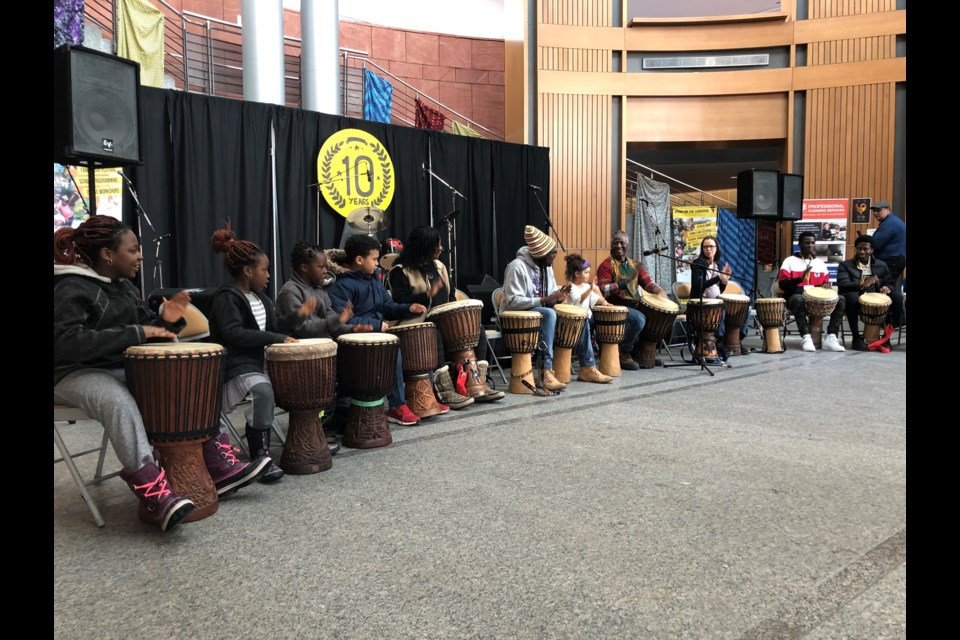 Children and volunteers participate in a drum cirlce at Bring on the Sunshine at Kitchener City Hall. Phi Doan/KitchenerToday