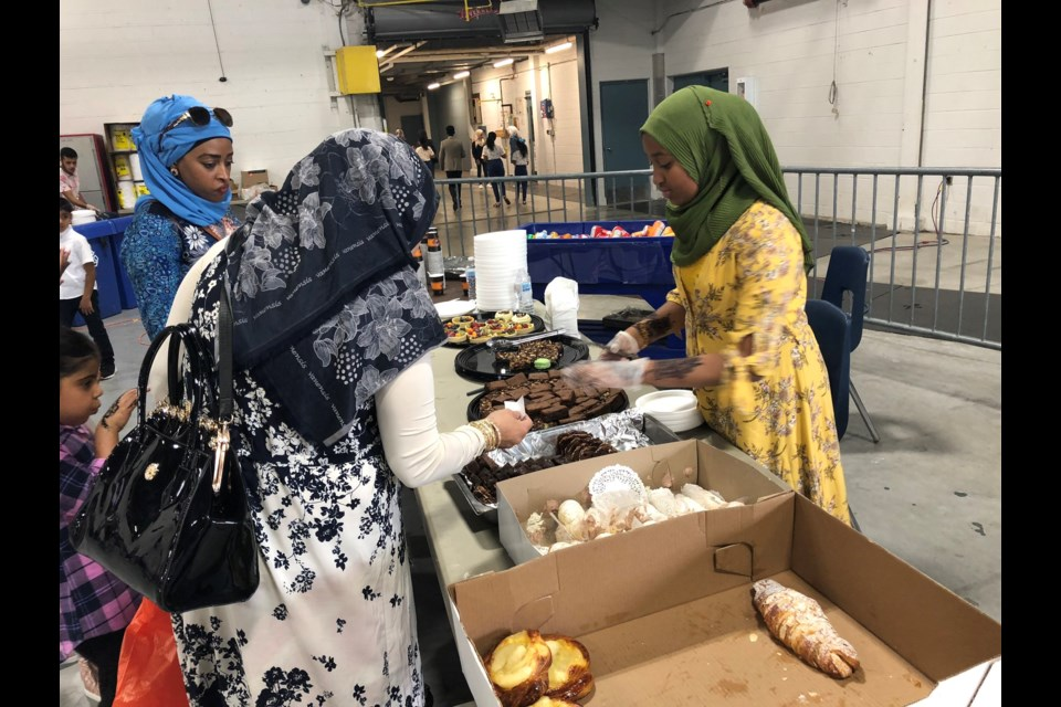 Residents gather at the Kitchener Auditorium to participate in celebrations hosted by the Muslim Association of Canada Waterloo chapter.Phi Doan/KitchenerToday
