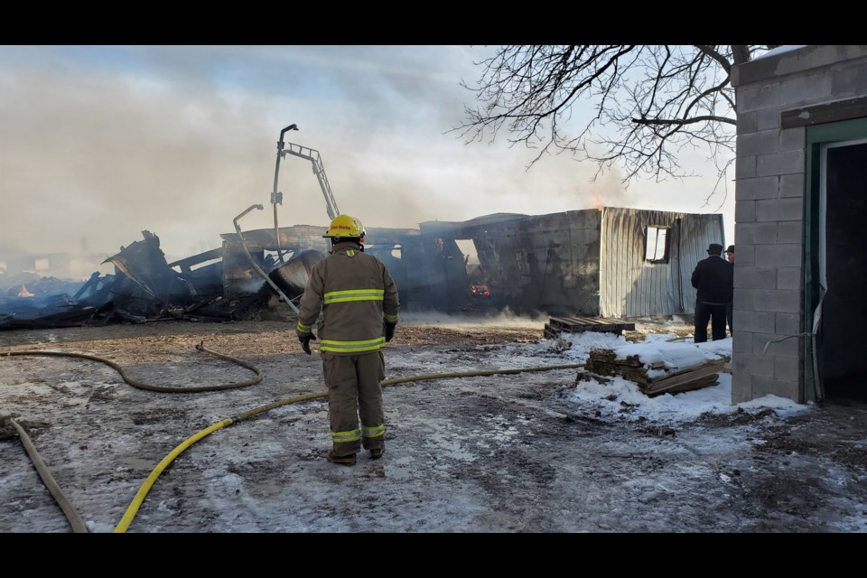 A firefighter looks over the damage after a barn fire near Elmira (January 9, 2020). Mark Pare/KitchenerToday
