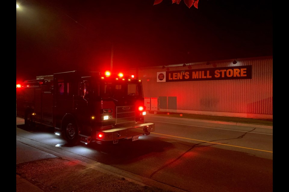 Fire trucks outside of Len's Mill Store in Woodstock. Photo from @WoodstockFireDe on Twitter.
