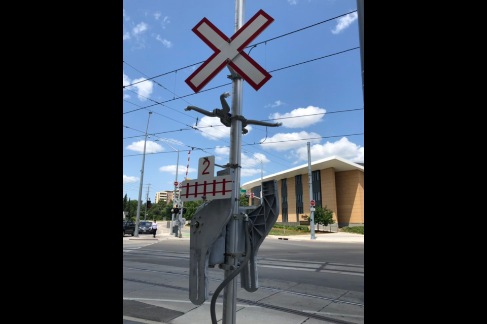 Pedestrian gates at the ION crossing at Erb and Caroline in Uptown Waterloo have been removed after they were deemed unnecessary. Ben Eppel/KitchenerToday