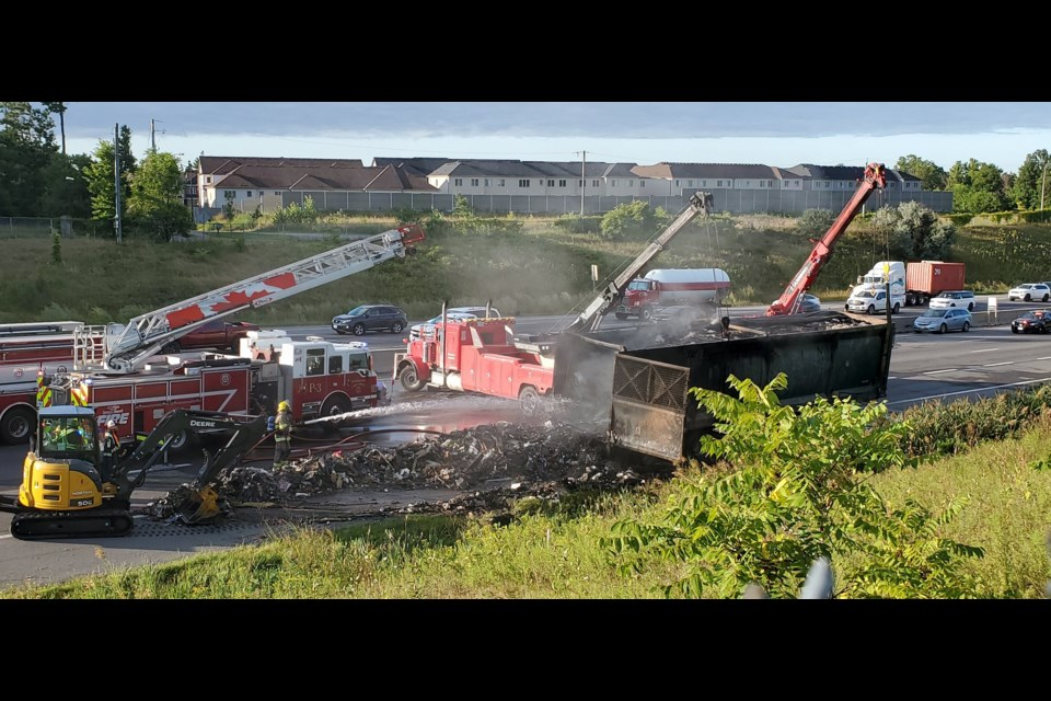 A transport truck loaded with garbage caught fire on the westbound 401 near Highway 8 (August 29, 2019). Mark Pare/KitchenerToday