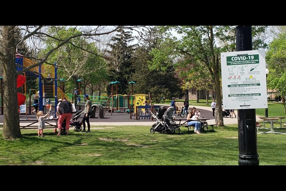 Individuals enjoy outdoor activities in Victoria Park, Kitchener.