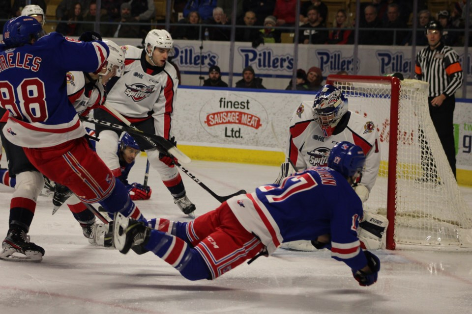 Kitchener Rangers forward Mike Petizian (17) goes to the ice after getting a puck on net.   Mark Pare/KitchenerToday