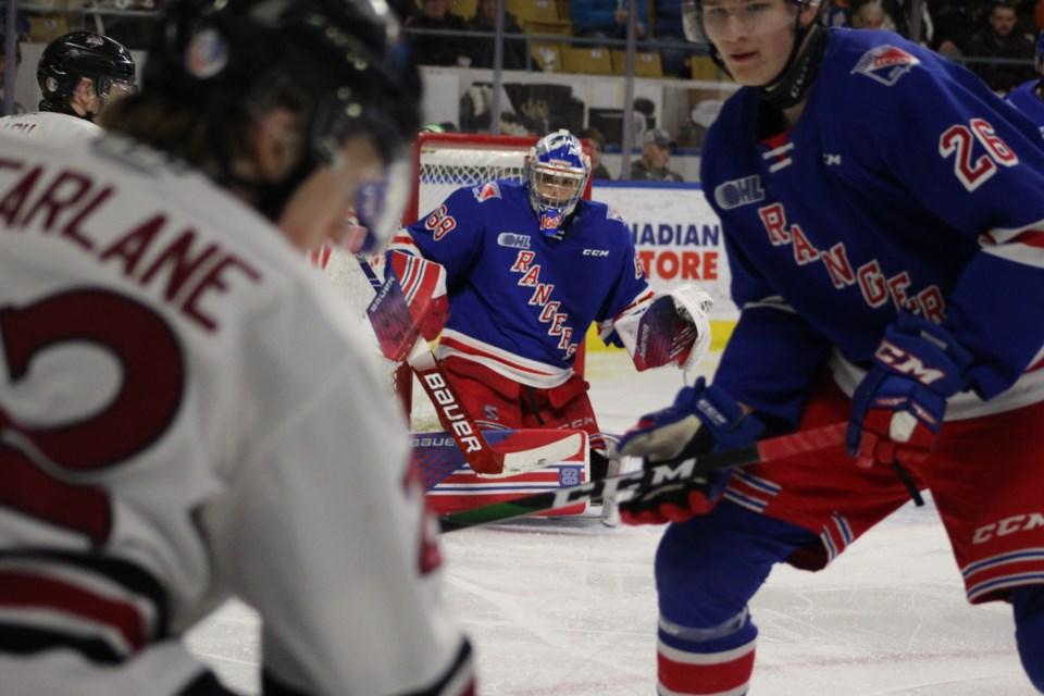 Kitchener Rangers goaltender Jacob Ingham looks at the play developing along the boards.  Mark Pare/KitchenerToday