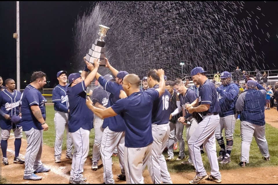 The Barrie Baycats celebrate their sixth straight IBL championship at Jack Couch Park in Kitchener, Saturday night.  Mark Pare/KitchenerToday
