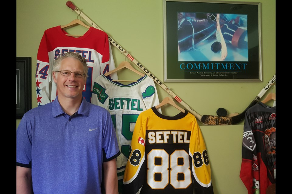 Steve Seftel stands in the basement of his Waterloo home, which is filled with memorabilia from his playing days. Blair Adams/Kitchener Today