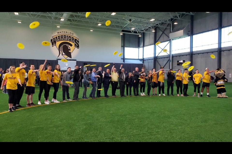 Officials tossed frisbees to signify the opening of the University of Waterloo's new field house, situated just north of Warrior Field.  Mark Pare/KitchenerToday