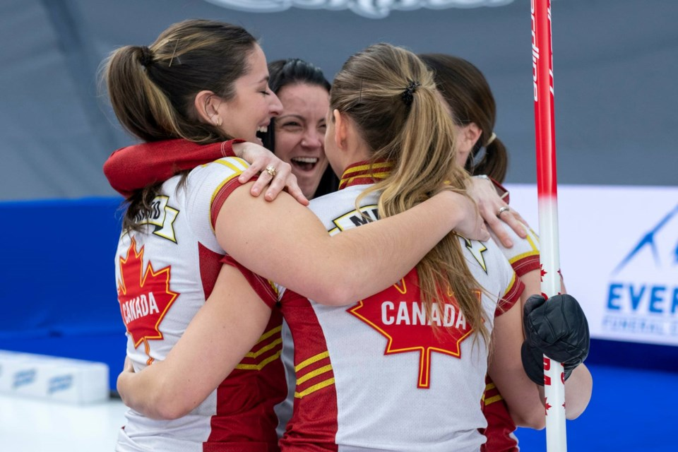 Team Canada celebrates their win on Sunday night.