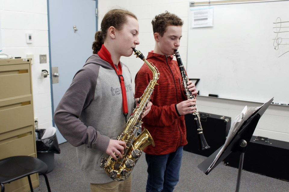 Twins Joshua (left) and Michael Gamblin (right), Grade 8 students at H.E. Bourgoin Middle School, are among junior and senior high school students participating in the University of Alberta High School Honour Band. Photo by Robynne Henry.