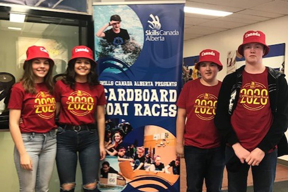 École des Beaux-Lacs was among the groups that participated in the Skills Canada Alberta's Northern Cardboard Boat Races at NAIT on Monday, Feb. 3. (left to right) Grade 9 students Cloé Beaupré and Solana Gandolfi, and Grade 8 students Christian Lavoie and Xavier Wilson. Photo submitted.
