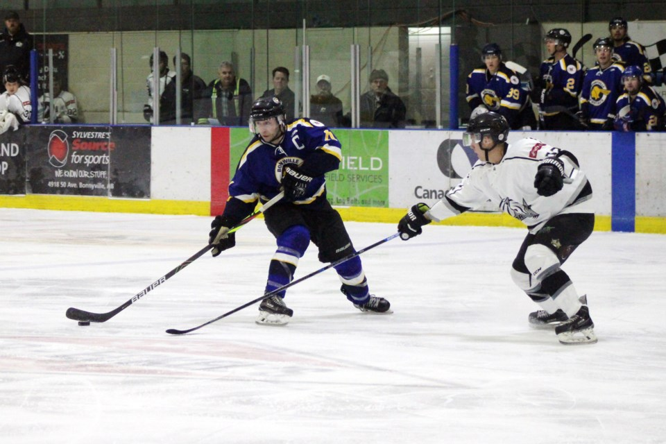 During the Bonnyville Sr. Pontiacs fourth game in their playoff series against the Morinville Kings, Lucas Isley keeps the puck away from the Kings' defensive line. Photo by Robynne Henry.