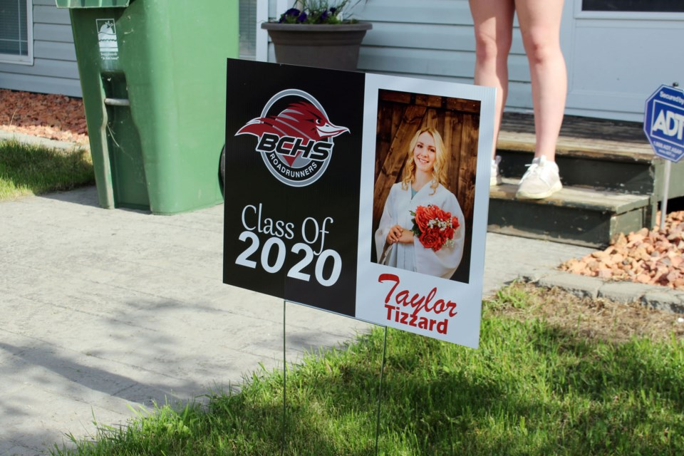 Staff and teachers from Bonnyville Centralized High School drove around town on Friday, June 12 delivering yard signs, diplomas, and caps and gowns to the 2020 graduating class. Photo by Robynne Henry.