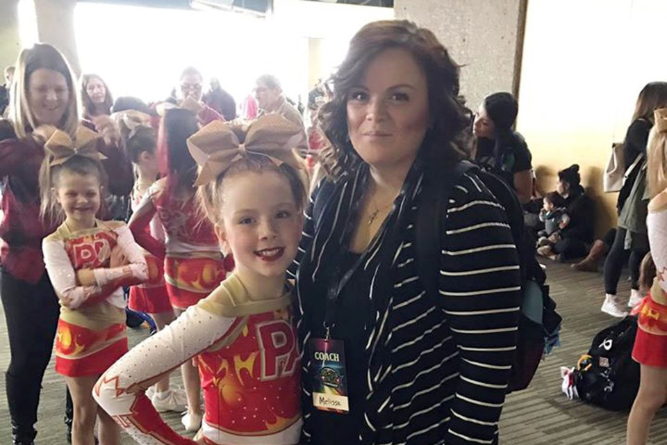 Bonnyville's Premier Academy Cheerleading and Tumbling owner and coach  Melissa Kirkendall along with her daughter, Allee Kirkendall. Melissa was named the all-star novice coach of the year by the Alberta Cheerleading Association. Photo submitted.