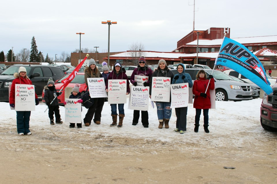 A rally was held at the Bonnyville Healthcare Centre on Thursday by nurses to raise awareness about the proposed cuts to healthcare. Photo by Robynne Henry.
