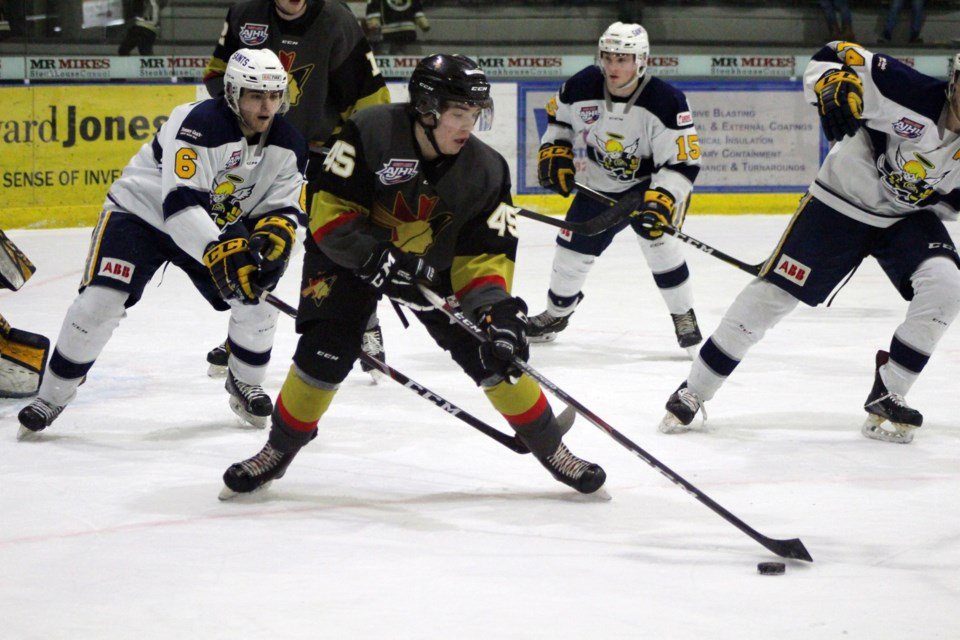 During the Bonnyville Jr. A Pontiacs game against the Spruce Grove Saints on Wednesday, Feb. 12, Matthew McKim keeps control of the puck. Photo by Robynne Henry.