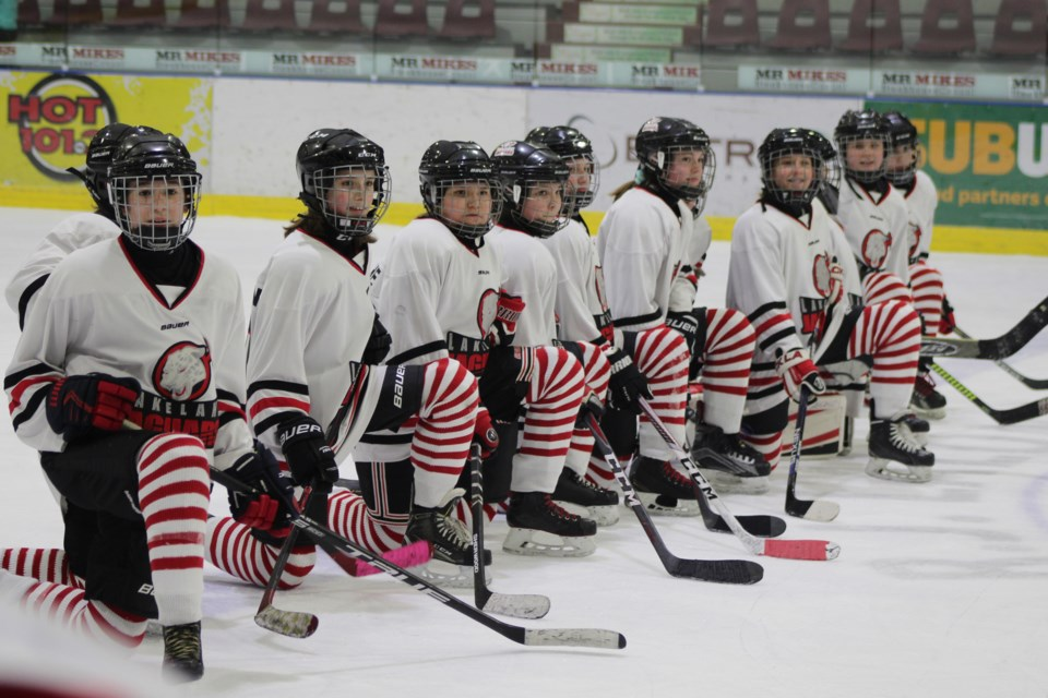 Atom and peewee teams donned the Ronald McDonald House Charities' iconic red and white striped socks for the third annual Winterland Invitational from Feb. 14 to 16 in Bonnyville, Glendon, and Elk Point. Photo by Robynne Henry.