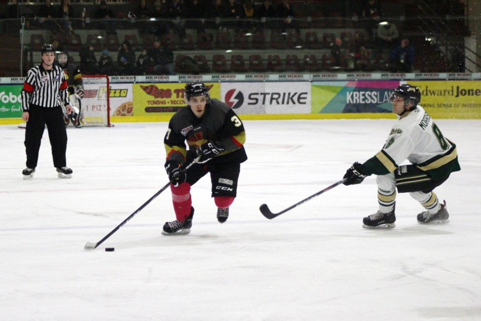 During the Bonnyville Jr. A Pontiacs game against the Okotoks Oilers on Saturday, Jan. 18, Jaxsen Wyatt keeps the puck away from his opponents. Photo by Robynne Henry.