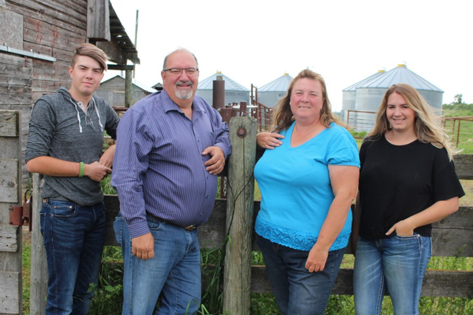 Charlotte Lake Farms is among the local locations participating in Alberta Open Farm Days.  (left to right) Ben, Guy, Leona, and Catherine Bonneau. File Photo.