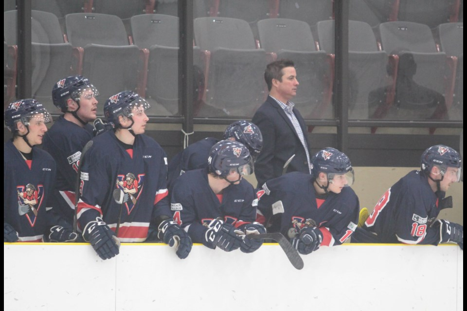 Portage College Athletics Director Nate Bedford (left) with assistant coach Kevin McLelland behind the Voyageurs bench during an early season game last year.    File / Rob McKinley
