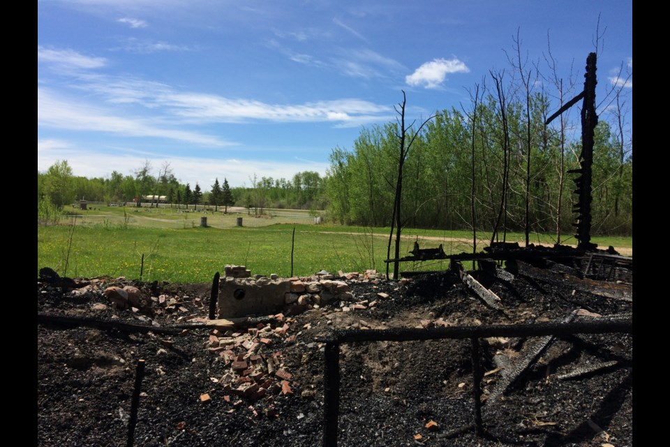 With the cemetery in the background, the black, charred remains of the Big Bay Church near Owl River, about 20 kilometres north of the Lac La Biche hamlet.