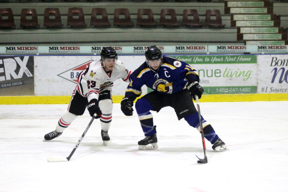 During the Bonnyville Sr. AA Pontiacs game against the Westlock Warriors on Sunday, Jan. 5, Lucas Isley fights for control of the puck. Photo by Robynne Henry.