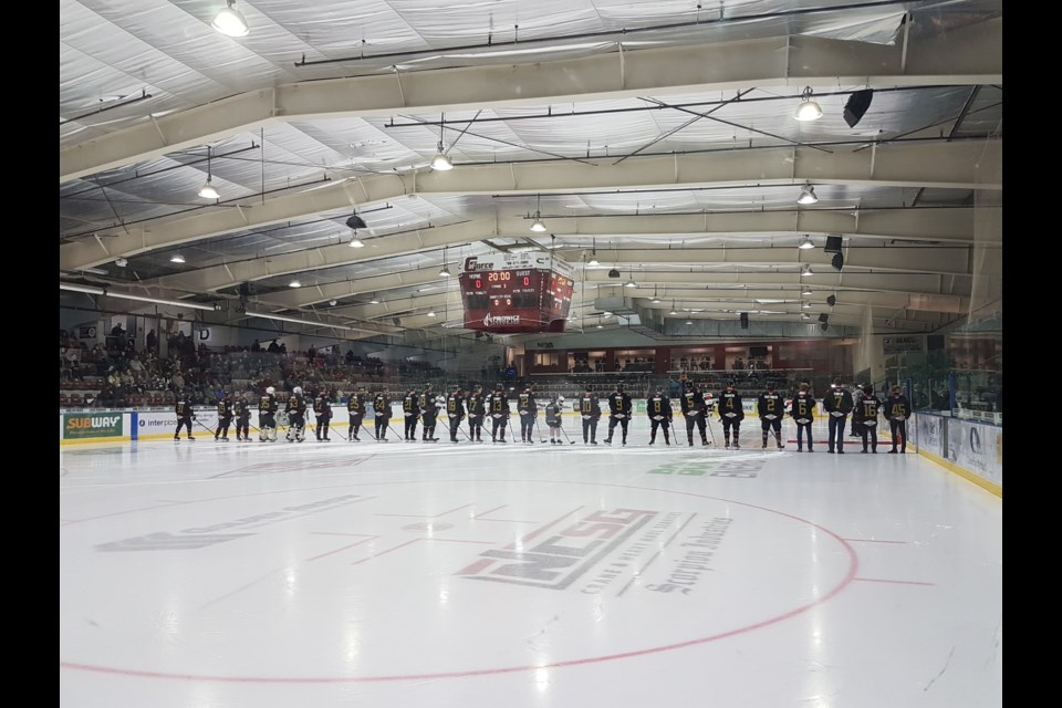 The Pontiacs AJHL team line up for the 2021-2022 regular season at the home opener in the R.J. Lalonde arena.
