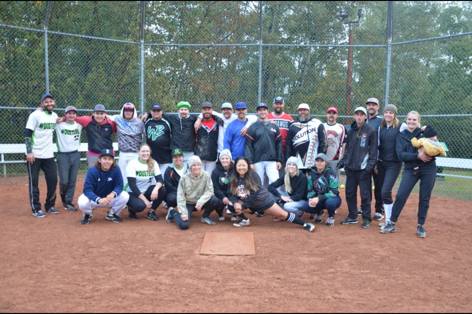 Top two teams pose together at the 2021 Stick it to Suicide Slo-pitch tournament.