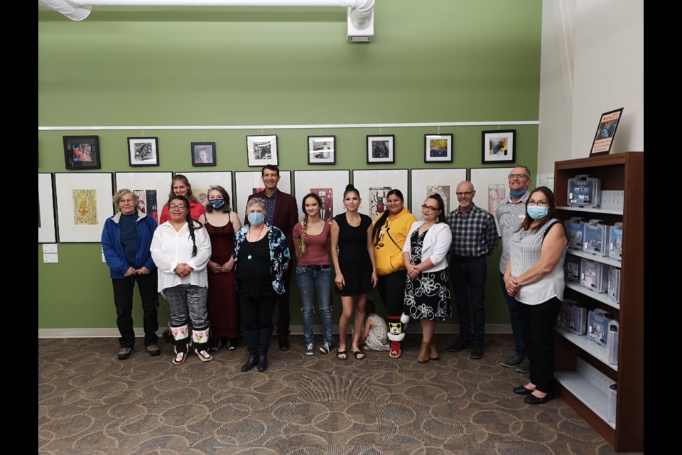 Group of artists and instructors and local leaders pose at closing ceremony for the Time Stamps: The Art of Reliefexhibition on Aug. 27.