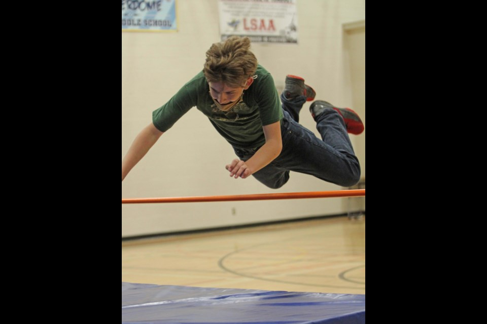 Superman dives over the high jump bar get tricky as the bar goes up.
