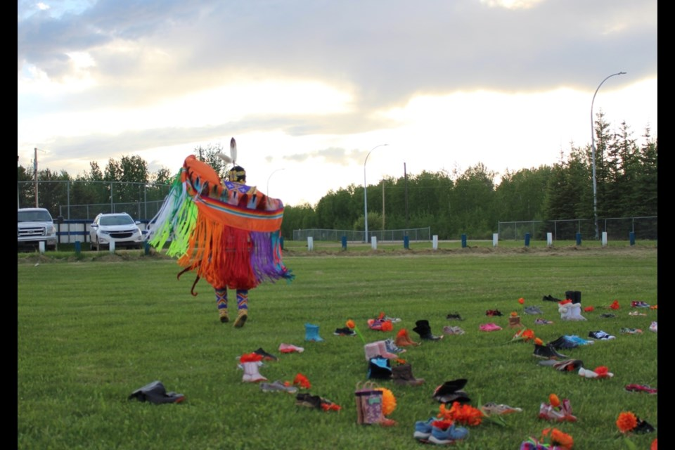 Dancer Alicia Cardinal performs a tribute dance at the Buffalo Lake Metis Settlement's 215 event on Thursday.