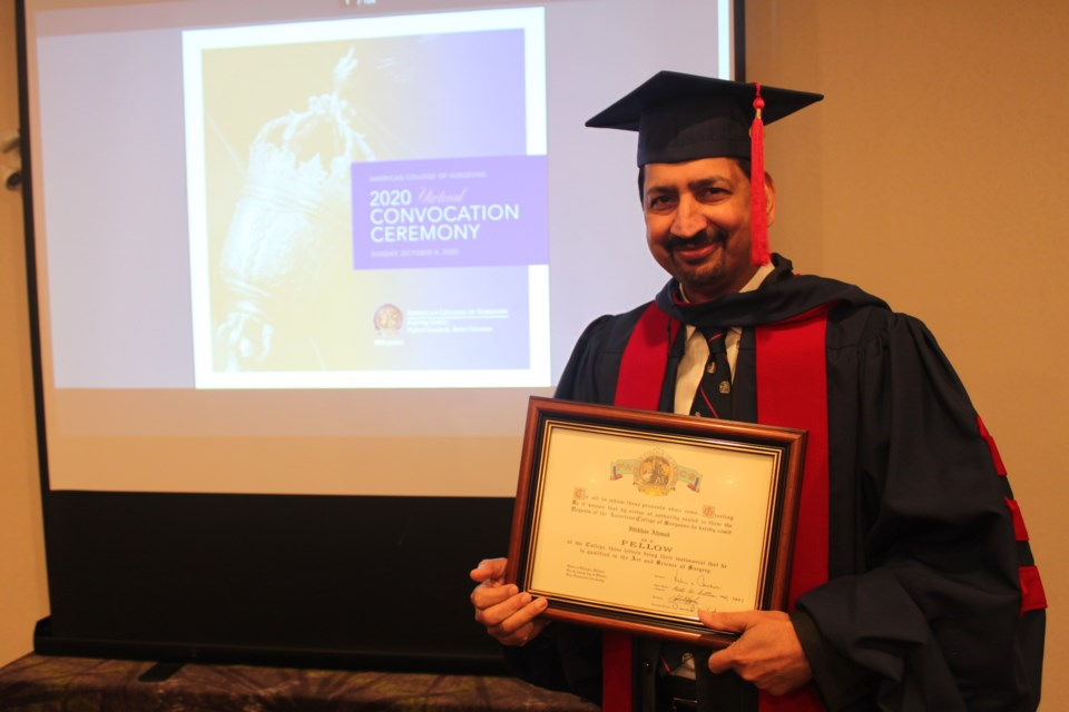 Dr. Iftikhar Ahmad was inducted a Fellow into American College of Surgeons Oct. 4. Clare Gauvreau photo.