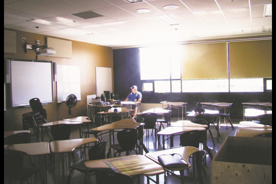 Before students do come back to area classrooms, teachers and administrators will have to carefully plan each step of the government's re-entry plan and how it applies to their classrooms.                            Rob McKinley / file
