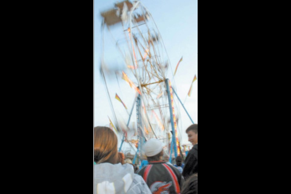 Will a midway ride spin into Lac La Biche at the end of July.