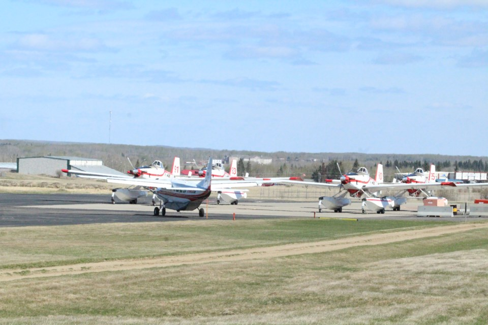 The 'bird-dog' spotter plane and the Air Tractor water bombers at the Lac La Biche Air Tanker base.
