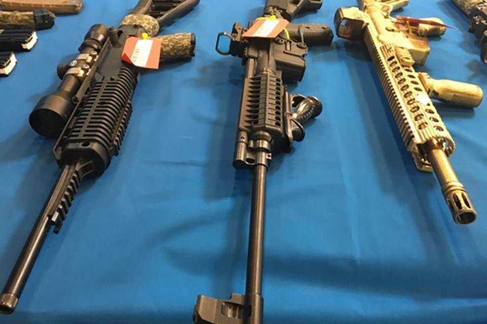 A number of firearms have been seized by police and two men from Saddle Lake have been charged.