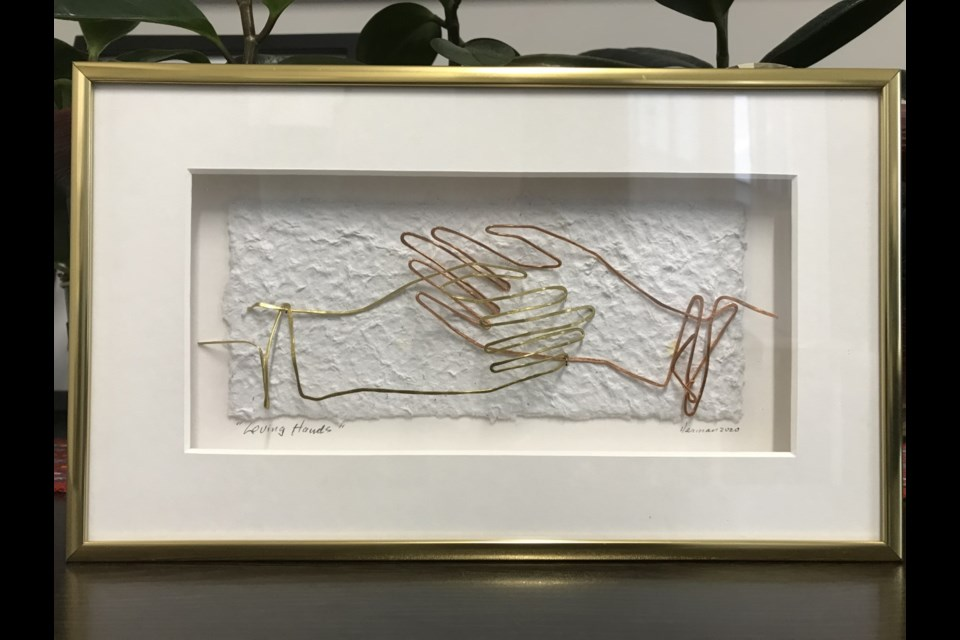 A one-of-a-kind piece of art was presented to Noreen Cotton, executive director with the Capella Centre, on Nov. 17, in honour of her retirement.
