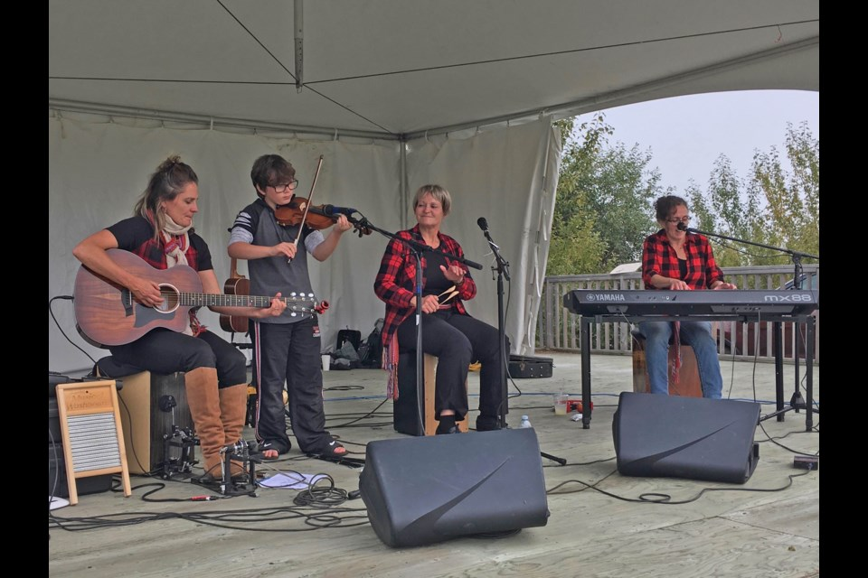Girlz with Guitarz, Tracy Lord, her sister Karen Levoir and their aunt Michele Gauthier performed all weekend, even offering set with Lord's son Helix accompanying them.       Photo: Crystal Plamondon
