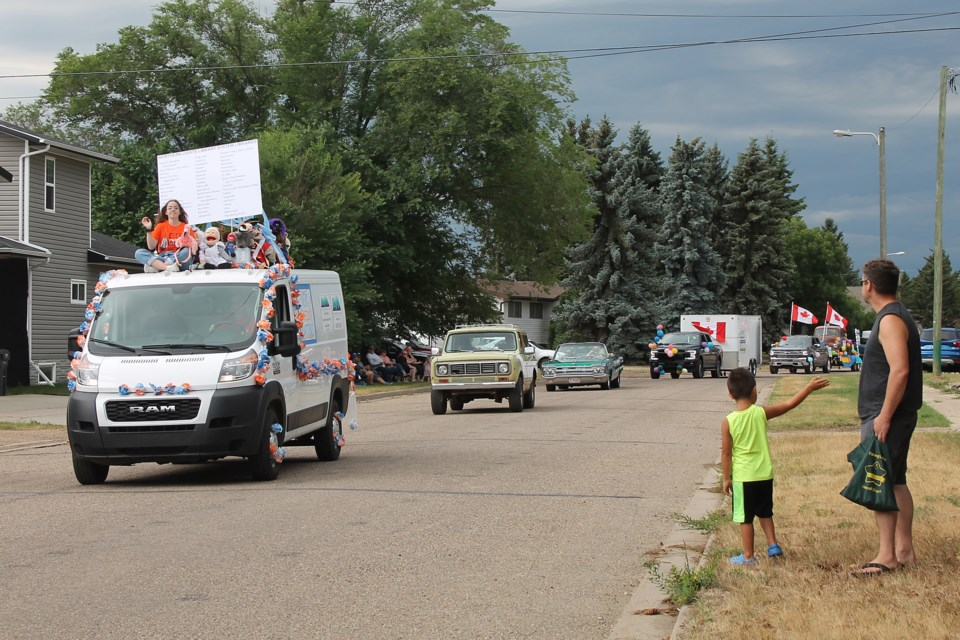 Dark clouds were gathering in the west as the Northern Lights Library System's Every Child Matters float, classic vehicles and other entries made their way past the Elk Point Curling Club as the Heritage Days parade headed back to its starting point.