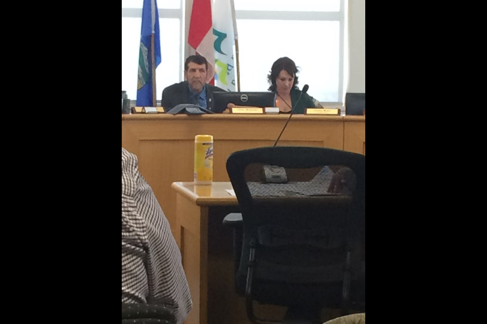 A disinfectant bottle sits on the delegation table awaiting county staff to update Lac La Biche County Mayor Omer Mogrhabi, Deputy Mayor Charlyn Moore and the rest of council at Tuesday's special COVID council meeting.